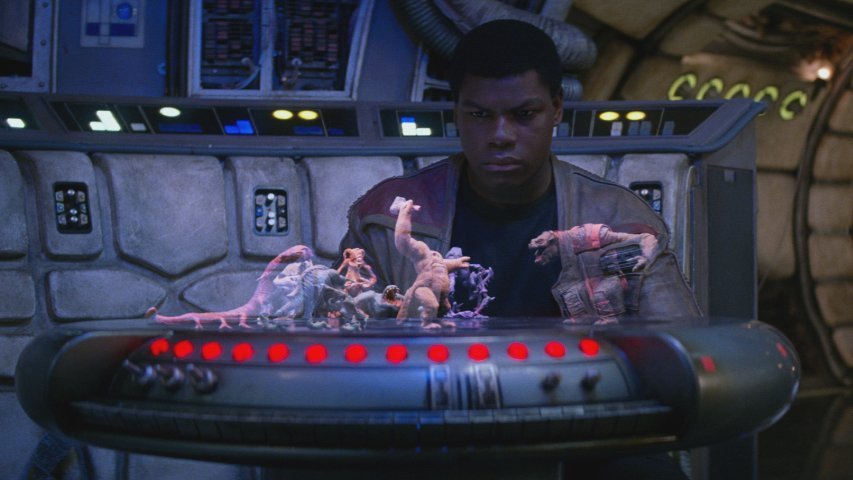 Finn looking at a dejarik board in The Force Awakens.
